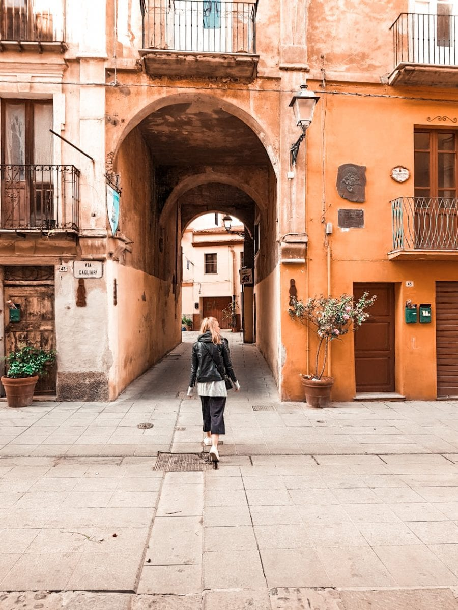 girl walking through typical italian city