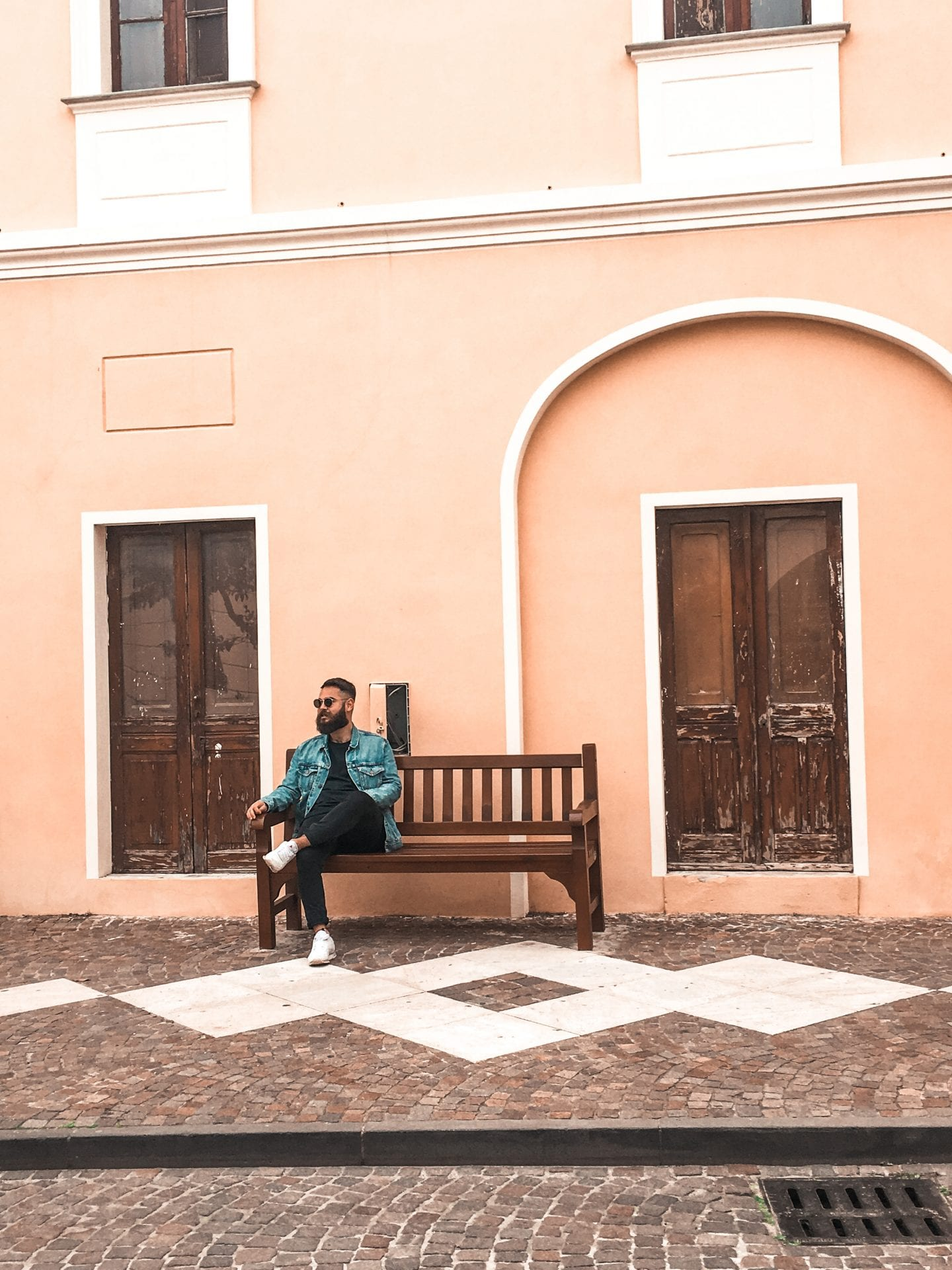 boy sitting in front of italian house