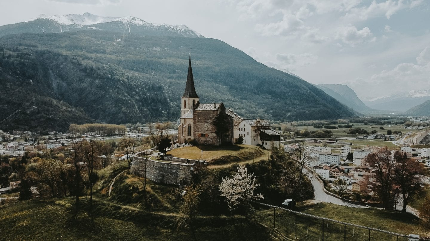 church on a hill in raron swiss alps